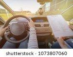 examiner filling in driver's... | Shutterstock . vector #1073807060