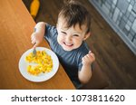 a child in a t shirt in the... | Shutterstock . vector #1073811620