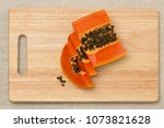 a papaya fruit is cut into... | Shutterstock . vector #1073821628
