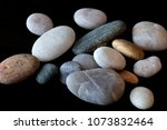 river pebbles on a black... | Shutterstock . vector #1073832464