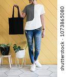 woman showing black totebag.... | Shutterstock . vector #1073865080