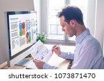 businessman working on a... | Shutterstock . vector #1073871470