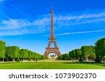 paris eiffel tower and champ de ... | Shutterstock . vector #1073902370