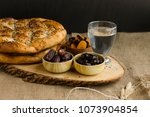 iftar meal  time to break the...   Shutterstock . vector #1073904854