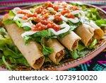 flautas de pollo  chicken tacos ... | Shutterstock . vector #1073910020