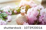 gold perfumes bottle. oil.... | Shutterstock . vector #1073920016