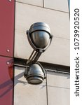 Small photo of modern street all-weather double-sided lamp on the new building