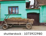 an old hay cart is standing at...   Shutterstock . vector #1073922980