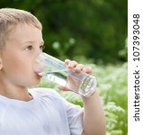 child drinking pure water in... | Shutterstock . vector #107393048