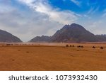 evening time near mountains at... | Shutterstock . vector #1073932430