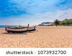 beach at seaside in calella in... | Shutterstock . vector #1073932700