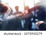 handshaking business person in... | Shutterstock . vector #1073933279