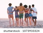 group of happy friends having... | Shutterstock . vector #1073933324