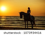 silhouette of a woman at sunset ... | Shutterstock . vector #1073934416