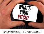 Small photo of Conceptual hand writing showing What Is Your Pitch Question. Business photo showcasing Present proposal Introducing Project or Product written on Mobile holding by man on the Jeans background.