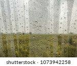 the rain falls on the glass ... | Shutterstock . vector #1073942258