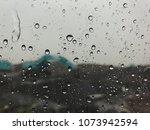 rain falls on a glass of fine... | Shutterstock . vector #1073942594