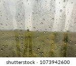 rain falls on a glass of fine... | Shutterstock . vector #1073942600