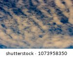 white  and grey cirrostratus... | Shutterstock . vector #1073958350
