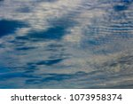 white  and grey cirrostratus... | Shutterstock . vector #1073958374