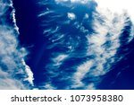 white  and grey cirrostratus... | Shutterstock . vector #1073958380