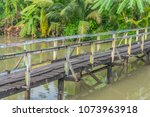 old wooden bridge with a... | Shutterstock . vector #1073963918