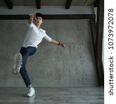 teenager guy in white sweater... | Shutterstock . vector #1073972078