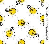 lightbulb seamless doodle... | Shutterstock .eps vector #1073987573