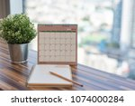 notebook with pencil diary on...   Shutterstock . vector #1074000284