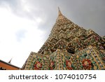 Small photo of Pagoda in dark day. Thailand. Generally in Thailand , any kinds of art decorated in Buddhist church, temple pavilion. temple hall, monk's house etc.They are public domain or treasure of Buddhi
