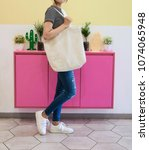 woman showing white totebag.... | Shutterstock . vector #1074065948