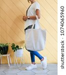 woman showing white totebag.... | Shutterstock . vector #1074065960