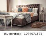 luxury bed in hotel room   Shutterstock . vector #1074071576