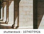 abstract columns corridor...   Shutterstock . vector #1074075926