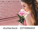 gorgeous young woman in posing... | Shutterstock . vector #1074086834