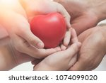 father's day concept. hands of... | Shutterstock . vector #1074099020