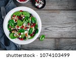 green salad spinach bowl with... | Shutterstock . vector #1074103499