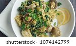 yellow rice with mushrooms and... | Shutterstock . vector #1074142799