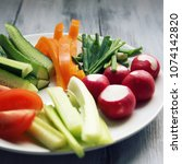white plate with vegetables for ... | Shutterstock . vector #1074142820