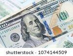 close up of new hundred dollar... | Shutterstock . vector #1074144509