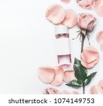 Stock photo cosmetic bottle with facial roses water or toner with essential oil flowers and petals on white 1074149753