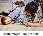 black mother plays with her... | Shutterstock . vector #1074155483