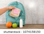 mother preparing for her... | Shutterstock . vector #1074158150