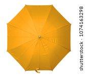 orange umbrella isolated on... | Shutterstock . vector #1074163298