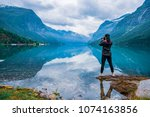 nature photographer tourist... | Shutterstock . vector #1074163856