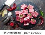 fresh pork meat. raw sliced... | Shutterstock . vector #1074164330
