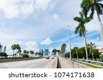 highway or roadway with cars... | Shutterstock . vector #1074171638
