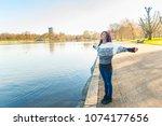 indian girl relaxing at park in ... | Shutterstock . vector #1074177656