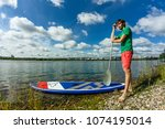 sup surfing man stand up paddle ...   Shutterstock . vector #1074195014