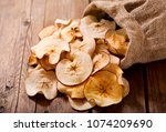 close up of dried apples on... | Shutterstock . vector #1074209690